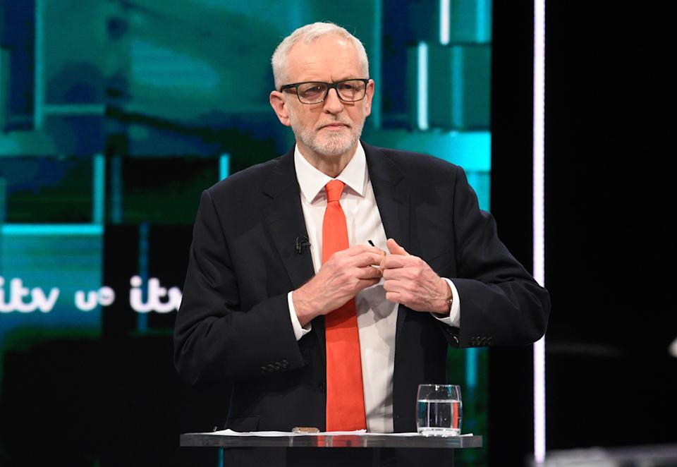 SALFORD, ENGLAND - NOVEMBER 19: (AVAILABLE FOR EDITORIAL USE UNTIL DECEMBER 19, 2019) In this handout image supplied by ITV,  Leader of the Labour Party Jeremy Corbyn arranges his glasses during the ITV Leaders Debate at Media Centre on November 19, 2019 in Salford, England. This evening ITV hosted the first televised head-to-head Leader's debate of this election campaign. Leader of the Labour party, Jeremy Corbyn faced Conservative party leader, Boris Johnson after the SNP and Liberal Democrats lost a court battle to be included. (Photo by Jonathan Hordle//ITV via Getty Images)