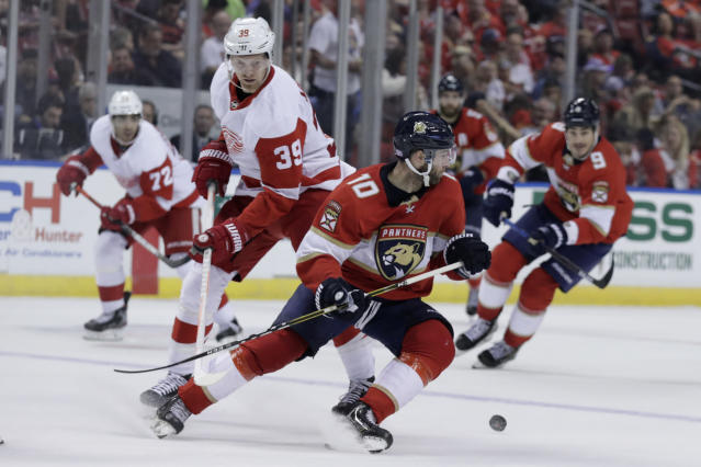 Florida Panthers right wing Brett Connolly (10) skates with the puck as Detroit Red Wings right wing Anthony Mantha (39) pursues during the second period of an NHL hockey game Saturday, Nov. 2, 2019, in Sunrise, Fla. (AP Photo/Lynne Sladky)