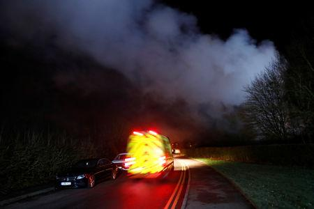 Emergency vehicles are seen following a large fire inside the George Bryan Centre at the Robert Peel Hospital in Tamworth, Britain, February 11, 2019. REUTERS/Eddie Keogh
