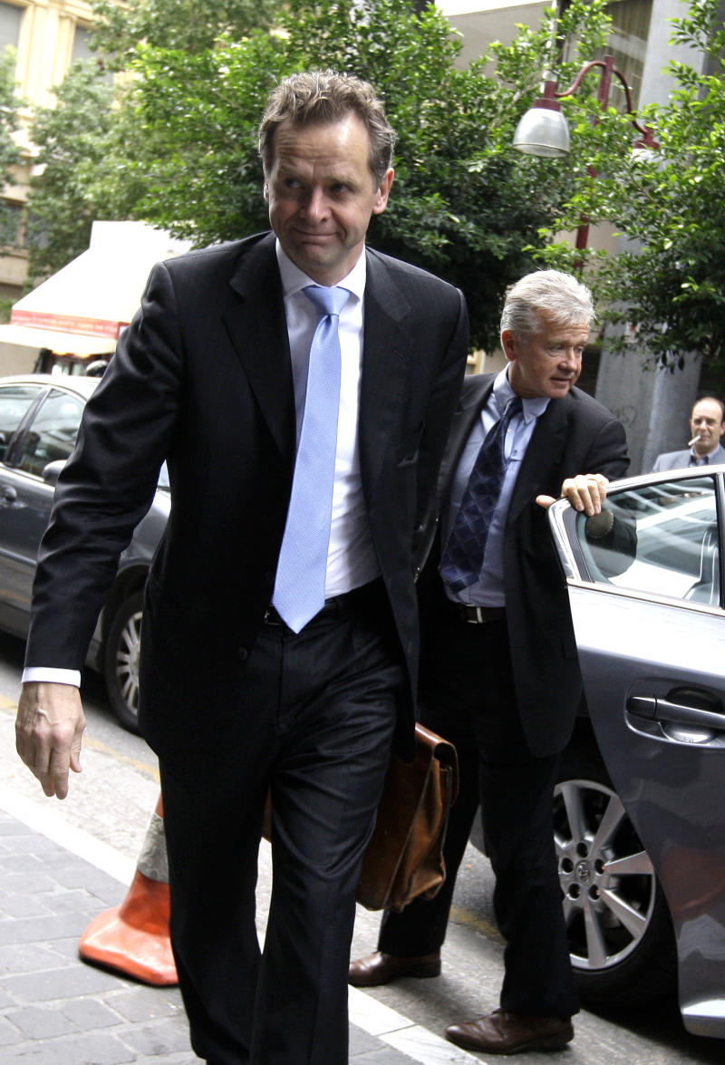 The International Monetary Fund's Poul Thomsen, foreground, and Gerry Rice, enter the Greek Finance Ministry, in central Athens, on  Monday, Nov. 15, 2010. The IMF and European delegation are in Athens to monitor progress on cost-cutting reforms. The inspection is required before the IMF and EU countries grant the third installment of rescue loans to debt-ridden Greece. (AP Photo/Petros Giannakouris)