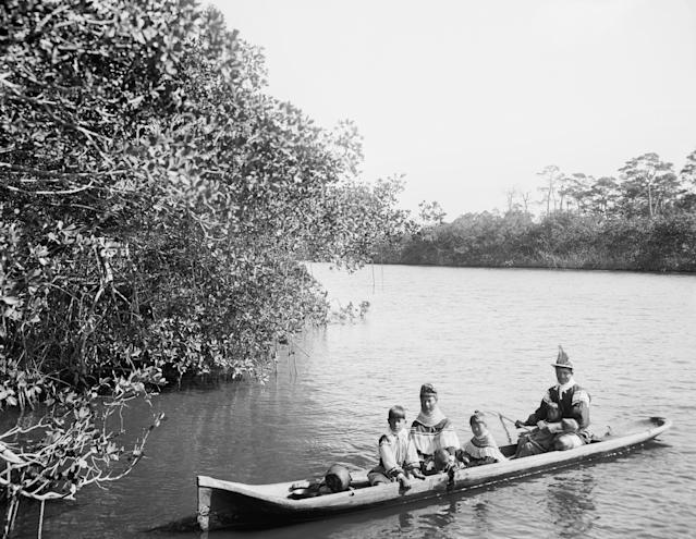 A photo taken in 1912 shows Seminole Indians in a dugout canoe on Florida's Miami River. (Universal History Archive via Getty Images)