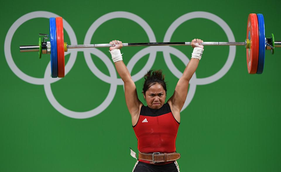 Philippines' Hidilyn Diaz competes during the women's 53kg weightlifting event at the Rio 2016 Olympic games in Rio de Janeiro on August 7, 2016. / AFP / GOH Chai Hin        (Photo credit should read GOH CHAI HIN/AFP via Getty Images)