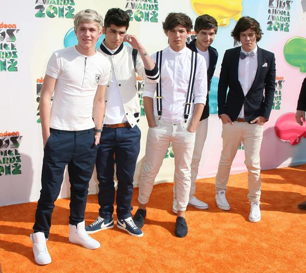 Kids' Choice Awards 2012 photos: Flying the British flag, One Direction not only looked cute on the red carpet, but gave an amazing performance of What Makes You Beautiful, too.