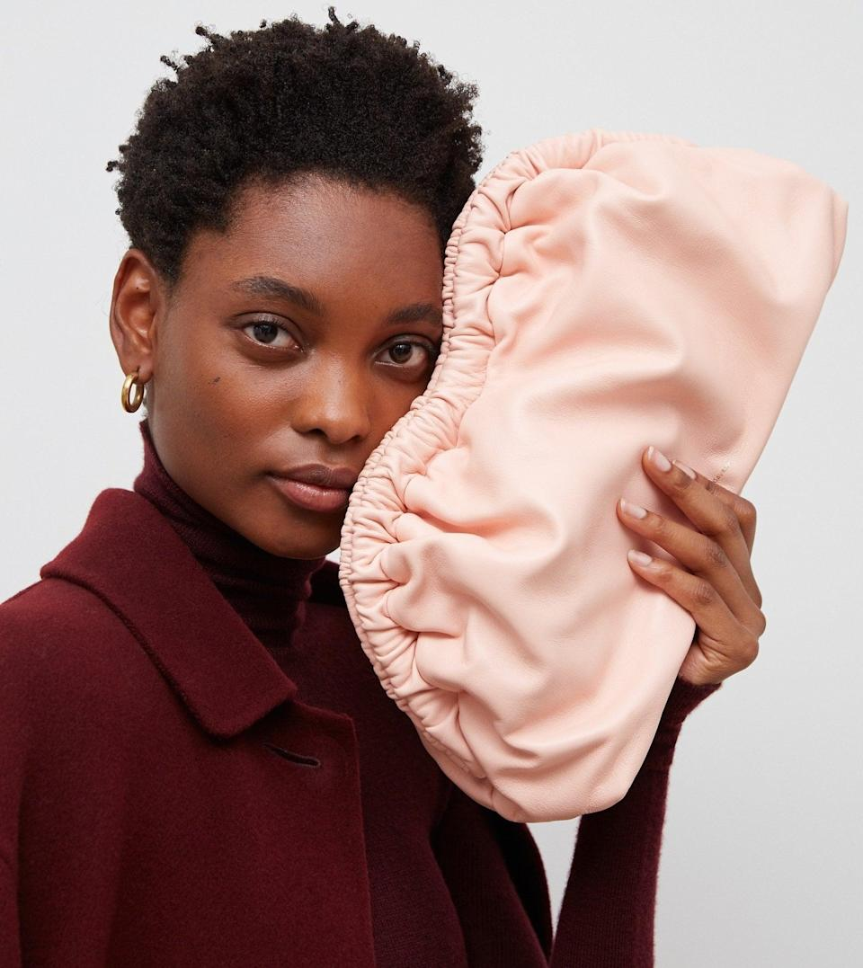 <p>If they're all about statement bags, then you'll want to treat them to this popular <span>Mansur Gavriel Cloud Clutch</span> ($595).</p>