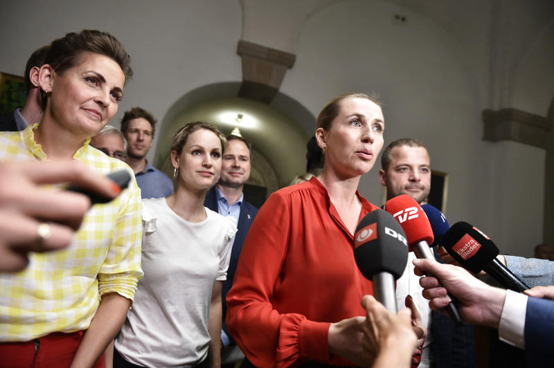 Leaders of left-wing parties in Denmark say they will back the center-left Social Democrats, with left to right, Pia Olsen Dyhr of the The Socialist People's Party, Pernille Skipper of The Red-Green Alliance, Mette Frederiksen of The Danish Social Democrats and Morten Oestergaard of The Social Liberal Party address the media after finalizing the government negotiations shortly after midnight at Christiansborg Castle in Copenhagen, Denmark, early Wednesday June 26, 2019.  Frederiksen announced that The Danish Social Democrats will form a minority government backed by three other left-wing parties. (Mads Claus Rasmussen/Ritzau Scanpix via AP)