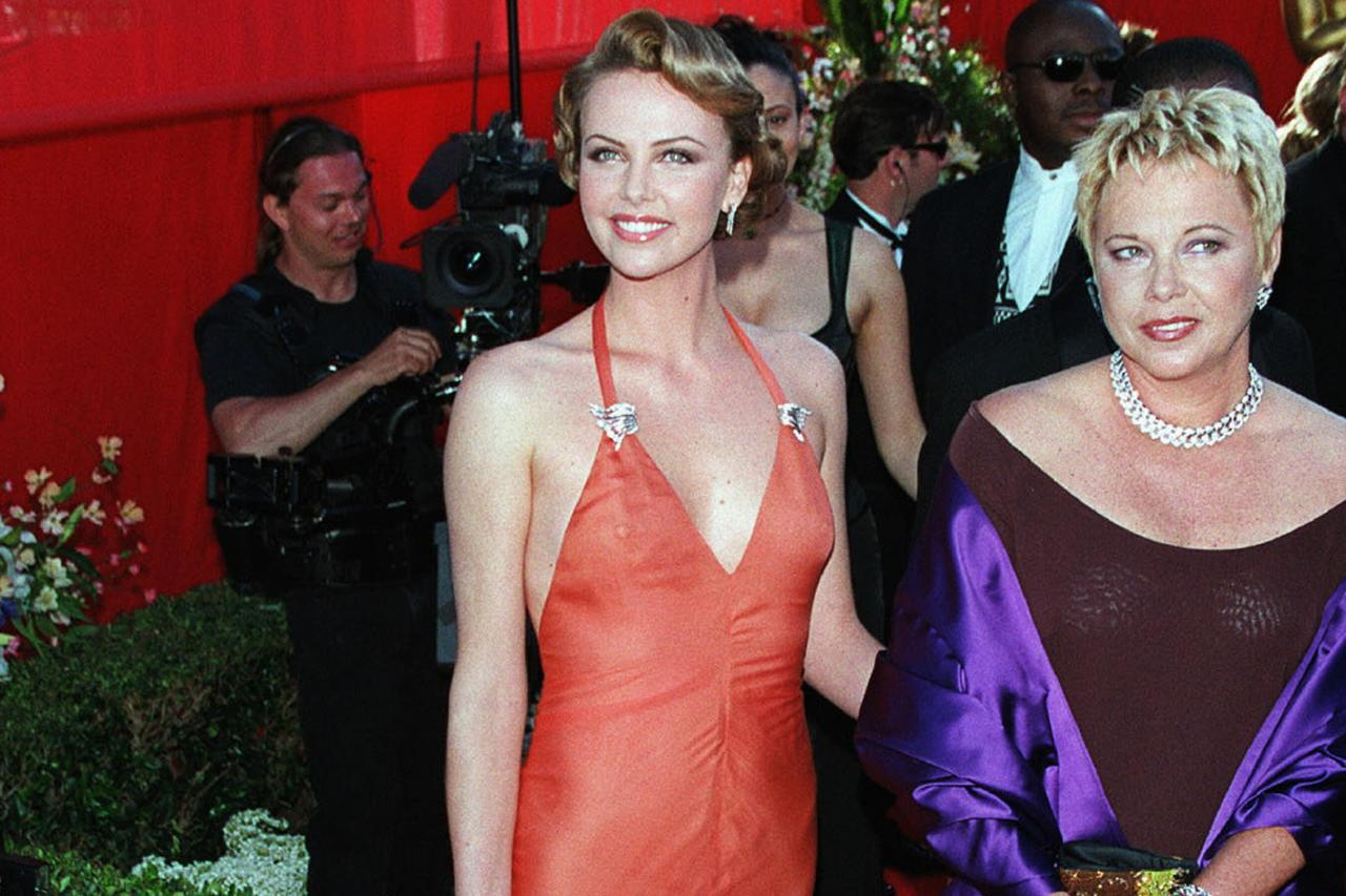 """<a href=""""https://ew.com/tag/charlize-theron/"""">Charlize Theron</a> was reunited with her <i>The Devil's Advocate</i> co-star <a href=""""https://ew.com/tag/keanu-reeves/"""">Keanu Reeves</a> when they presented the award for Best Original Score at the 2000 Academy Awards. Since then Theron has become an Oscars regular, with <i>Bombshell</i> marking her <a href=""""https://ew.com/movies/2019/10/16/bombshell-how-charlize-theron-transformed-into-megyn-kelly/"""">third nomination for Best Actress</a>. She previously has won the award for <i>Monster</i> and was <a href=""""https://ew.com/article/2005/10/21/talking-charlize-theron/"""">nominated for <i>North Country</i></a><i>. </i>"""