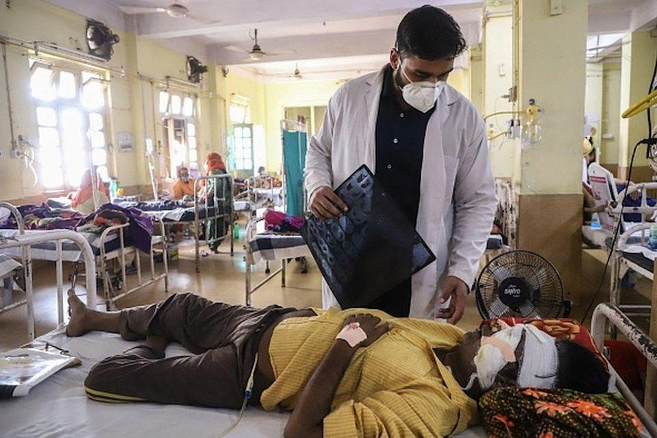A doctor assists a Covid-19 coronavirus patient with Black Fungus, a deadly and rare fungal infection, as he receives treatments at the NSCB hospital in Jabalpur, on May 20, 2021.