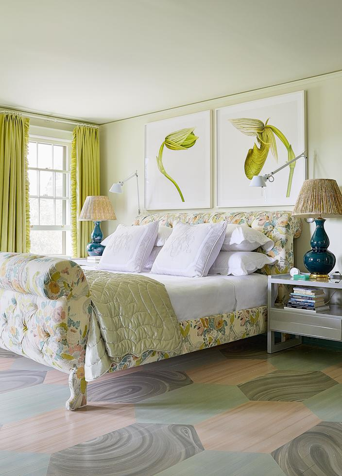 """<div class=""""caption""""> In the master bedroom, the bed is upholstered in a <a href=""""https://www.jeanmonro.com/"""" rel=""""nofollow noopener"""" target=""""_blank"""" data-ylk=""""slk:Jean Monro"""" class=""""link rapid-noclick-resp"""">Jean Monro</a> linen. Linens and satin quilt by <a href=""""https://leontinelinens.com/"""" rel=""""nofollow noopener"""" target=""""_blank"""" data-ylk=""""slk:Leontine Linens"""" class=""""link rapid-noclick-resp"""">Leontine Linens</a>; painted floor by <a href=""""https://www.bobchristiandecorativeart.com/"""" rel=""""nofollow noopener"""" target=""""_blank"""" data-ylk=""""slk:Bob Christian"""" class=""""link rapid-noclick-resp"""">Bob Christian</a>. </div> <cite class=""""credit"""">Photo: William Abranowicz</cite>"""