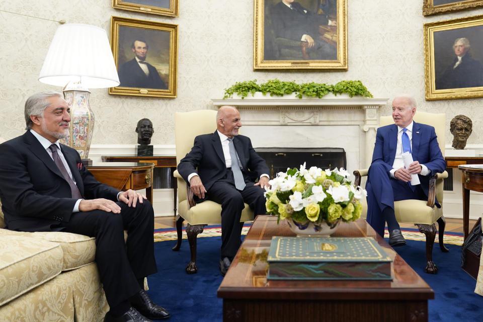 President Joe Biden meets with Afghan President Ashraf Ghani and Chairman of the High Council for National Reconciliation Abdullah Abdullah, left, in the Oval Office of the White House in Washington, Friday, June 25, 2021. (AP Photo/Susan Walsh)