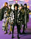 """<p>Never one to shy away from bright colors and patterns, Anna Sui stays true to that in her collection this season with the psychedelic-inspired style from the '60s that inspired R+Co co-founder <a href=""""https://www.instagram.com/garrennewyork/?hl=en"""" rel=""""nofollow noopener"""" target=""""_blank"""" data-ylk=""""slk:Garren"""" class=""""link rapid-noclick-resp"""">Garren</a> when curating hair looks for this show. </p>"""