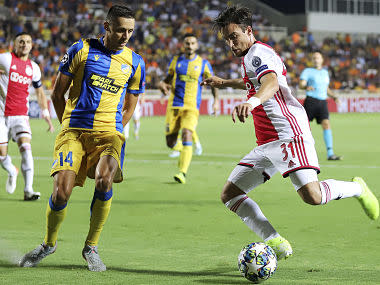 Champions League: 10-man Ajax held to goalless draw at APOEL in playoff round first-leg match; Slavia Prague beat CFR Cluj