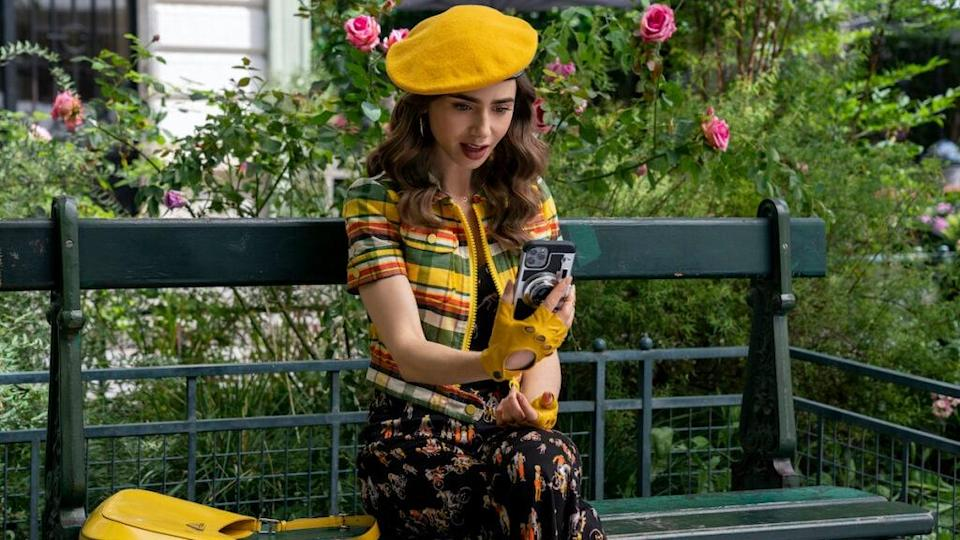 Emily in Paris. Lily Collins as Emily in episode 209 of Emily in Paris. Cr. Stéphanie Branchu/Netflix © 2021