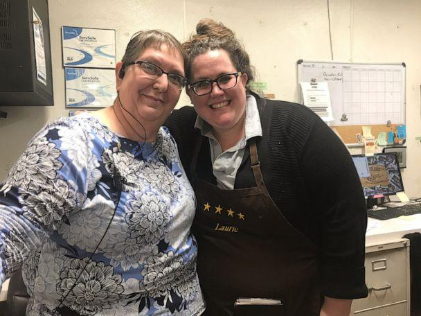 PHOTO: Laurie Malcom (right) with her manager Sherri Tomlin (left) at the Cracker Barrel in Dalton, Georgia. (Laurie Malcom)