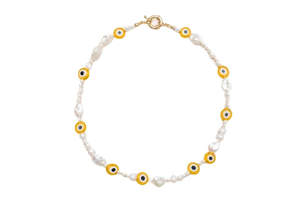 """$165, Eliou. <a href=""""https://www.eliou-eliou.com/collections/necklaces/products/pearly-eyed-yellow-necklace"""" rel=""""nofollow noopener"""" target=""""_blank"""" data-ylk=""""slk:Get it now!"""" class=""""link rapid-noclick-resp"""">Get it now!</a>"""