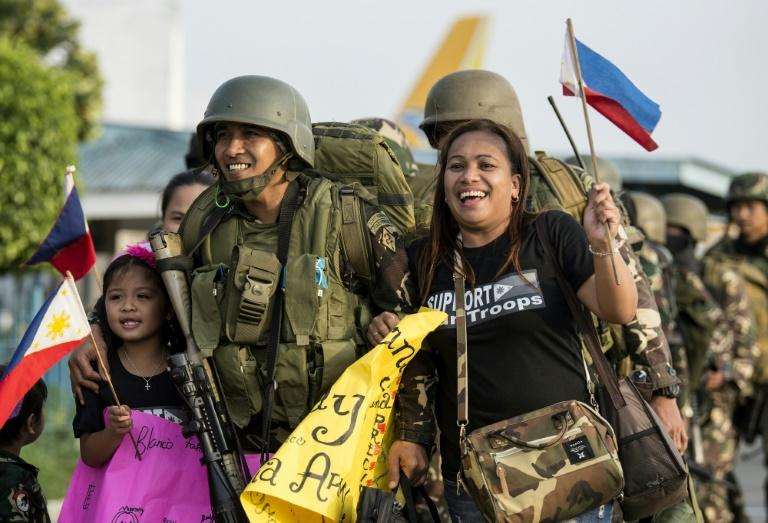 Philippine soldiers greeted by relatives as they returned from Marawi's frontlines on Friday