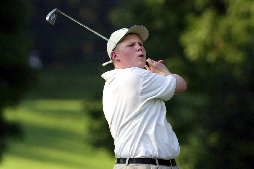 FILE - In this June 20, 2001, file photo, Andrew Giuliani, son of then-New York Mayor Rudolph Giuliani, follows through as he hits on the 11th hole at the Westchester Country Club during the 2001 Buick Classic West Course Pro-Am golf tournament in Harrison, N.Y. Giuliani was recruited for the golf team at Duke University but sued the university in 2008, saying he had been improperly cut from the team. Duke said the cut was based on bullying behavior, which Giuliani denied. The lawsuit was dismissed in 2010. (AP Photo/Kathy Willens, File)