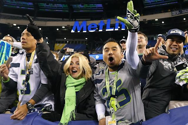 Seattle Seahawks fans celebrate after the NFL Super Bowl XLVIII football game Sunday, Feb. 2, 2014, in East Rutherford, N.J. The Seahawks won 43-8. (AP Photo/Paul Sancya)