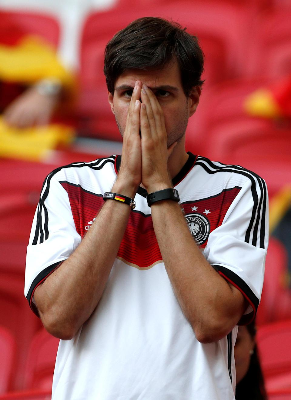 <p>Germany fan looks dejected after the match as they go out of the World Cup. REUTERS/John Sibley </p>