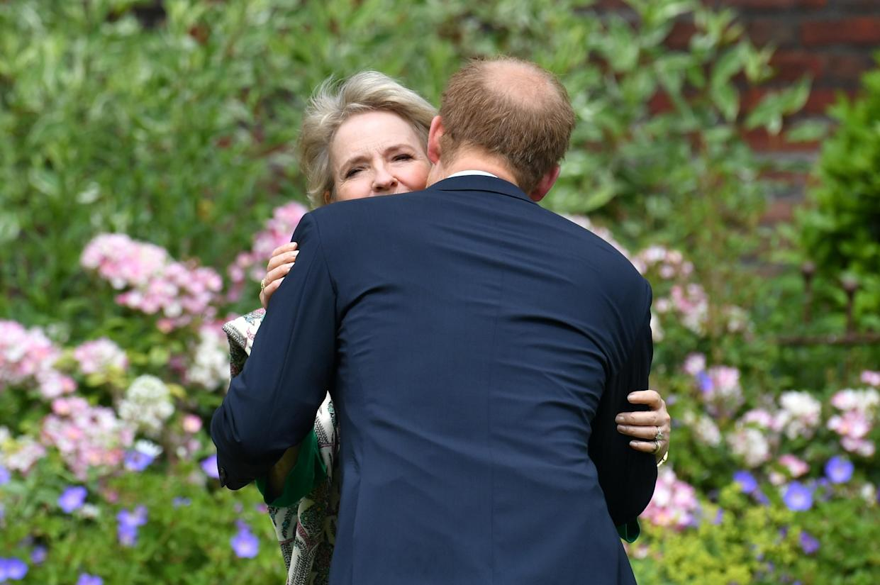 The Duke of Sussex greets Julia Samuel, founder of Child Bereavement UK, ahead of the unveiling of a statue of his mother Diana, Princess of Wales, in the Sunken Garden at Kensington Palace, London, on what would have been her 60th birthday. Picture date: Thursday July 1, 2021.