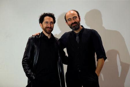 Kevork Mourad and Kinan Azmeh pose for a photograph after their performance in Beirut, Lebanon March 26, 2018. REUTERS/Mohamed Azakir