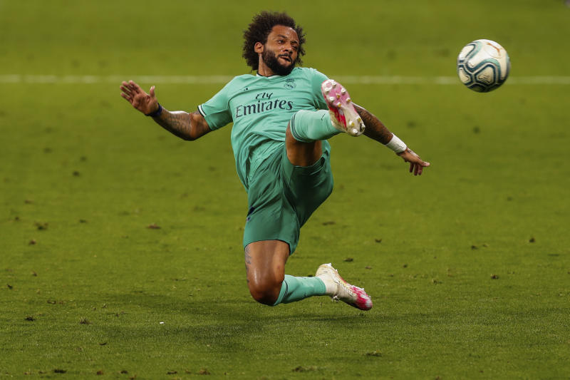 Real Madrid's Marcelo in action during the Spanish La Liga soccer match between RCD Espanyol and Real Madrid at the Cornella-El Prat stadium in Barcelona, Spain, Sunday, June 28, 2020. (AP Photo/Joan Monfort)