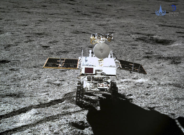 In this photo provided Jan. 12, 2019, by China National Space Administration via Xinhua News Agency, the rover Yutu-2 is seen in a photo taken by the lander of the Chang'e-4 probe on Jan. 11, 2019. China's space agency says it worked with NASA to collect data from the far side of the moon. The state-run China Daily said this was the first such collaboration since an American law banned joint space projects with China that do not have prior congressional approval. (China National Space Administration/Xinhua News Agency via AP)