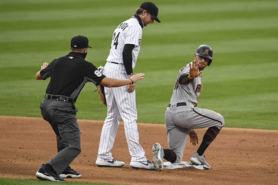DENVER, CO - AUGUST 11: Tim Locastro (16) of the Arizona Diamondbacks is called safe as Ryan McMahon (24) of the Colorado Rockies covers him after a double at Coors Field on Tuesday, August 11, 2020. (Photo by AAron Ontiveroz/MediaNews Group/The Denver Post via Getty Images)