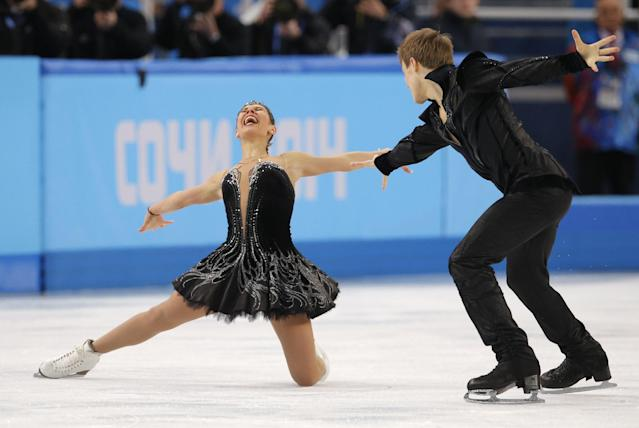 Elena Ilinykh and Nikita Katsalapov of Russia react after completing their routine in the ice dance free dance figure skating finals at the Iceberg Skating Palace during the 2014 Winter Olympics, Monday, Feb. 17, 2014, in Sochi, Russia. (AP Photo/Vadim Ghirda)
