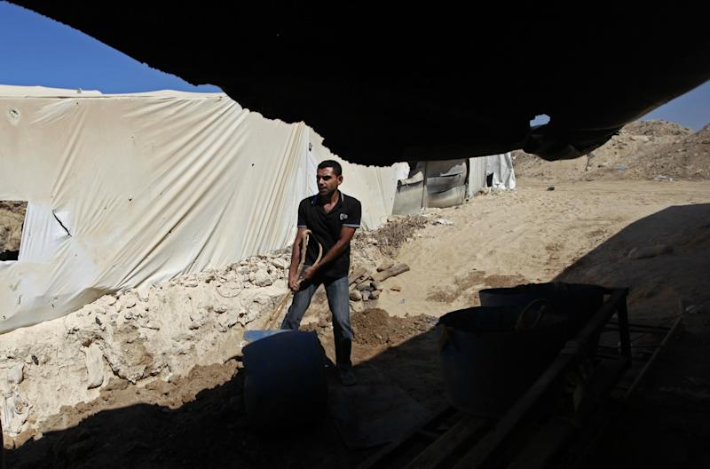 In this Monday, Sept. 30, 2013 photo, a Palestinian works outside a tunnel in Rafah, on the border between Egypt and the southern Gaza Strip. Since the summer, Egypt's military has tried to destroy or seal off most of the smuggling tunnels under the Gaza-Egypt border, a consequence of the heightened tensions between Cairo and the Hamas government in Gaza. (AP Photo/Hatem Moussa)
