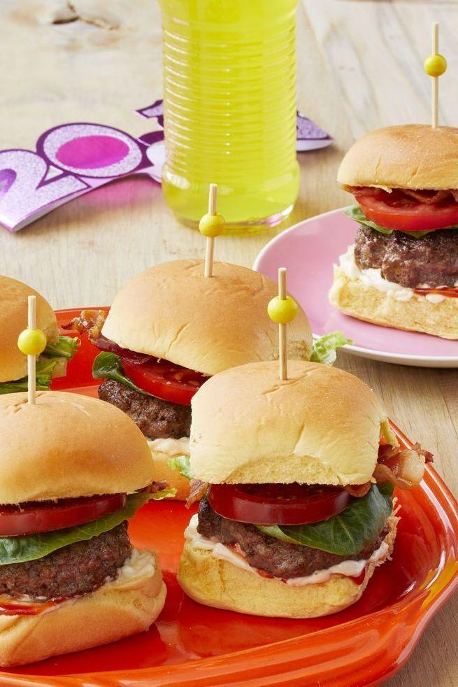 """<p>Two party favorites join forces for a seriously epic burger. Serve at a lunch cookout or save for later in the night—they're an excellent late-night snack!</p><p><strong><a href=""""https://www.thepioneerwoman.com/food-cooking/recipes/a35729197/blt-slider-recipe/"""" rel=""""nofollow noopener"""" target=""""_blank"""" data-ylk=""""slk:Get the recipe"""" class=""""link rapid-noclick-resp"""">Get the recipe</a>.</strong></p><p><a class=""""link rapid-noclick-resp"""" href=""""https://go.redirectingat.com?id=74968X1596630&url=https%3A%2F%2Fwww.walmart.com%2Fbrowse%2Fhome%2Fthe-pioneer-woman-dishes%2F4044_623679_639999_7373615&sref=https%3A%2F%2Fwww.thepioneerwoman.com%2Ffood-cooking%2Fmeals-menus%2Fg32157273%2Ffourth-of-july-appetizers%2F"""" rel=""""nofollow noopener"""" target=""""_blank"""" data-ylk=""""slk:SHOP PLATES"""">SHOP PLATES</a></p>"""