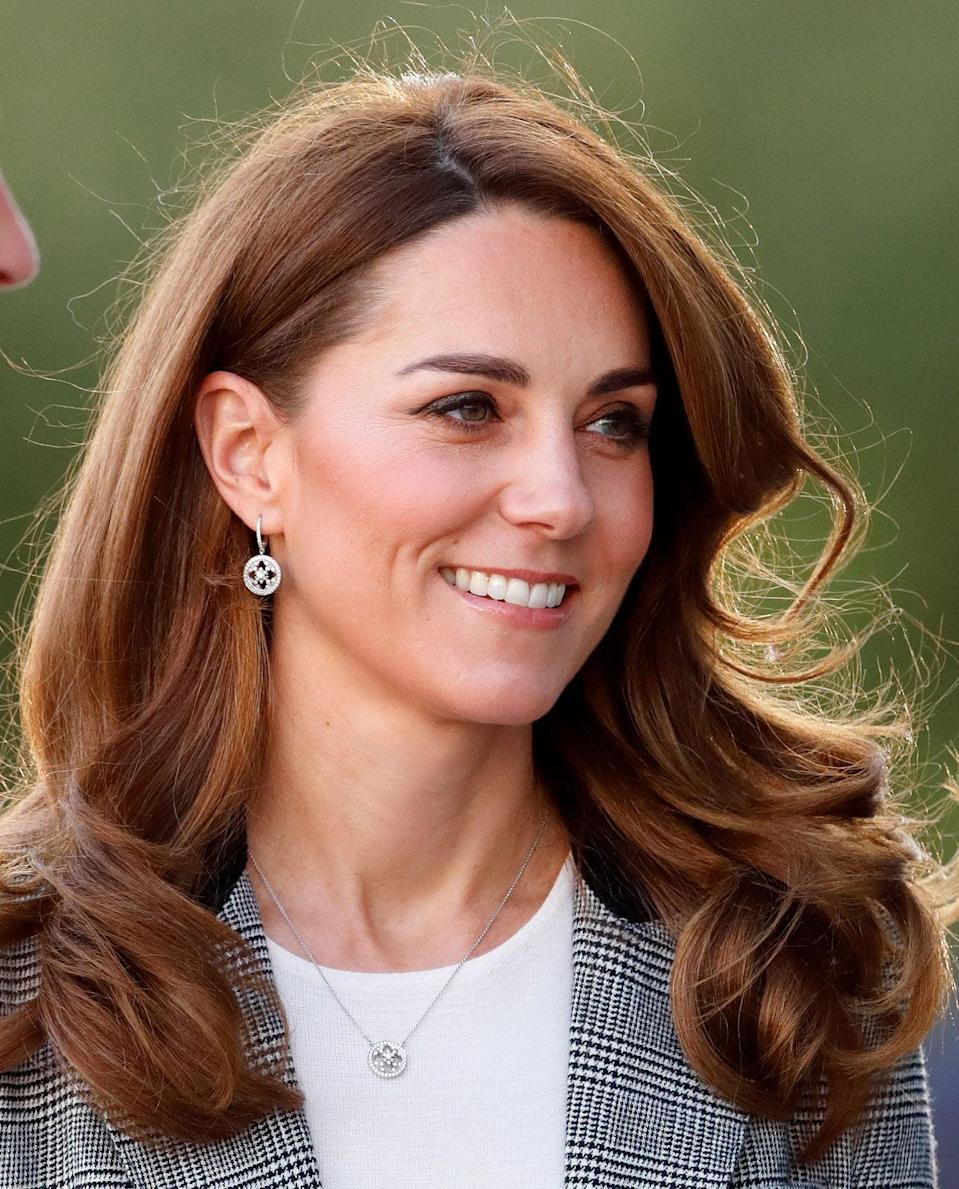 <p>The fact the duchess has enviably thick, bouncy hair is no secret, but she really took it up a notch with this side-parted blowout for a royal appearance in November. </p>