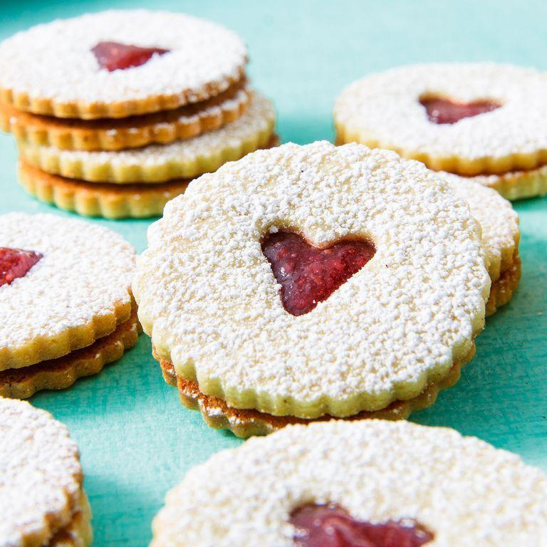 """<p>We love the combination of the flavourful, rich cookie and the sweet fruity jam.</p><p>Get the <a href=""""https://www.delish.com/uk/cooking/recipes/a28976870/classic-linzer-cookies-recipe/"""" rel=""""nofollow noopener"""" target=""""_blank"""" data-ylk=""""slk:Jam Sandwich Biscuits"""" class=""""link rapid-noclick-resp"""">Jam Sandwich Biscuits</a> recipe.</p>"""