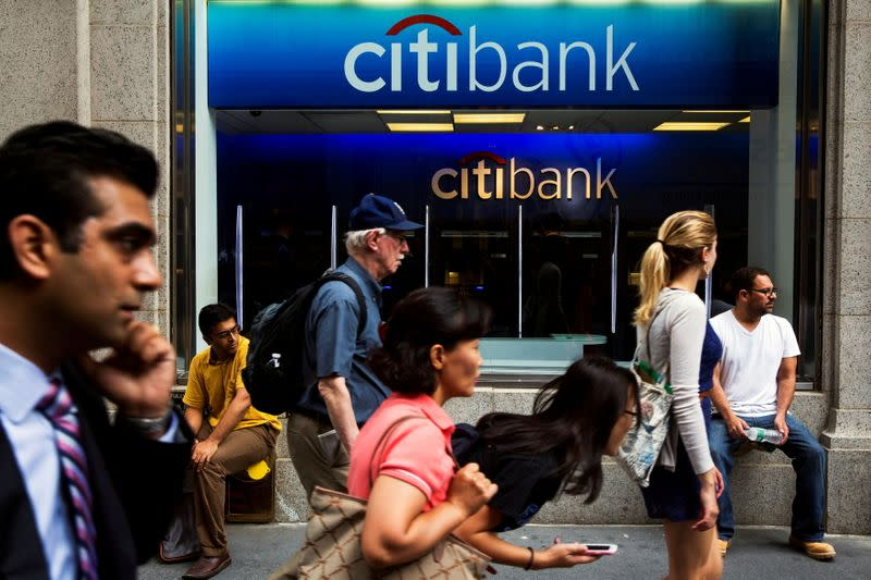 FILE PHOTO: Pedestrians walk past the facade of a Citibank building in New York