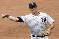 FILE - New York Yankees third baseman DJ LeMahieu throws to first during a baseball game against the Baltimore Orioles at Yankee Stadium in New York, in this Sunday, Sept. 13, 2020, file photo. The New York Yankees and AL batting champion DJ LeMahieu worked Friday, Jan. 15, 2021, to put in place a six-year contract worth about $90 million, a person familiar with the deal told The Associated Press. The person spoke on condition of anonymity because the agreement is subject to a successful physical. (AP Photo/Kathy Willens, File)