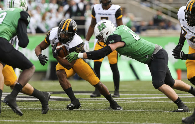 "Marshall's Blake Keller (44) attempts to bring down Southern Mississippi running back <a class=""link rapid-noclick-resp"" href=""/ncaaf/players/242576/"" data-ylk=""slk:Ito Smith"">Ito Smith</a> (25) in an NCAA college football game in Huntington, W.Va., Saturday, Nov. 25, 2017. Southern Mississippi won, 28-27. (Sholten Singer/The Herald-Dispatch via AP)"