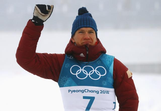Cross-Country Skiing - Pyeongchang 2018 Winter Olympics - Men's 50km Mass Start Classic - Alpensia Cross-Country Skiing Centre - Pyeongchang, South Korea - February 24, 2018 - Silver medallist Alexander Bolshunov, Olympic athlete from Russia, reacts during the victory ceremony. REUTERS/Kai Pfaffenbach