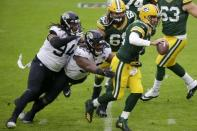 Green Bay Packers' Aaron Rodgers scrambles during the first half of an NFL football game against the Jacksonville Jaguars Sunday, Nov. 15, 2020, in Green Bay, Wis. (AP Photo/Mike Roemer)