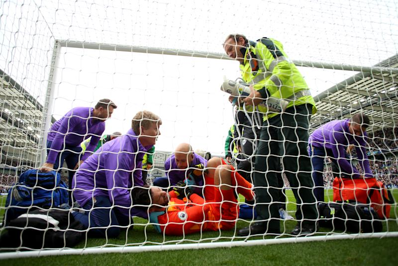 Hugo Lloris receives treatment. (Photo by Bryn Lennon/Getty Images)