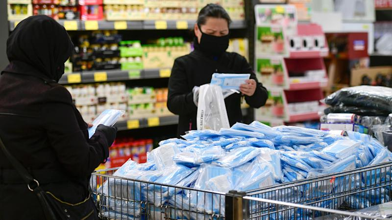 ALDI customers buying masks.