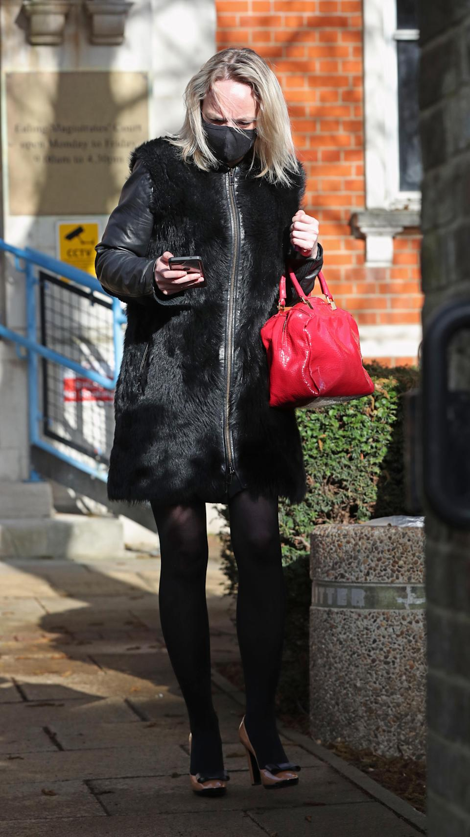 Rachel Street leaves Ealing Magistrates Court in London charged with being drunk in an aircraft during a Virgin Atlantic flight from Barbados to Heathrow in January. Picture date: Wednesday March 17, 2021.