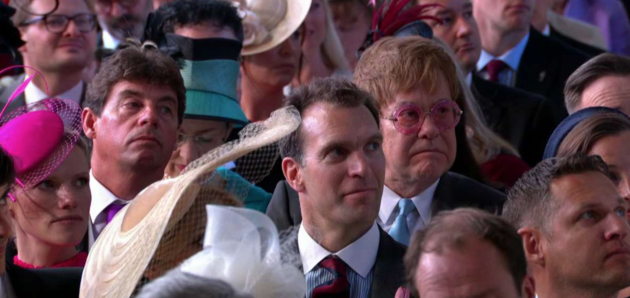 Even Elton John's iconic glasses could not mask his reaction to Michael Curry's address.