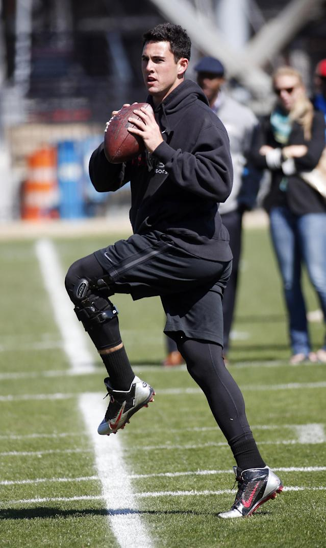 Georgia quarterback Aaron Murray works out for NFL football scouts during the school's pro day Wednesday, April 16, 2014 in Athens, Ga. (AP Photo/John Bazemore)