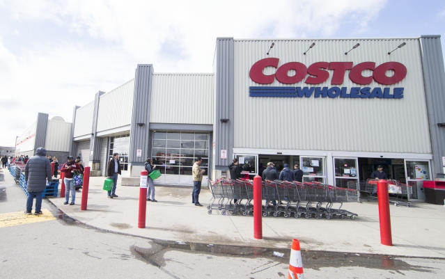 Customers line up with a social distance to enter a Costco warehouse store in Mississauga, Ont., on March 20, 2020. Canadian Prime Minister Justin Trudeau announced new measures Friday morning to mobilize manufacturers to quickly produce vital life-saving medical supplies against the COVID-19 pandemic in the country. As of Friday noon, Canada has confirmed 924 COVID-19 cases and 13 people died of the coronavirus. (Photo by Zou Zheng/Xinhua via Getty)