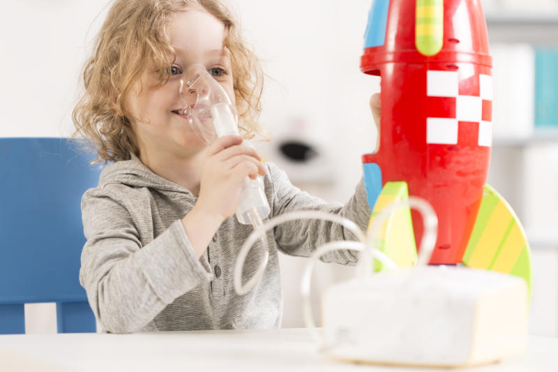 Child receiving therapy for cystic fibrosis.