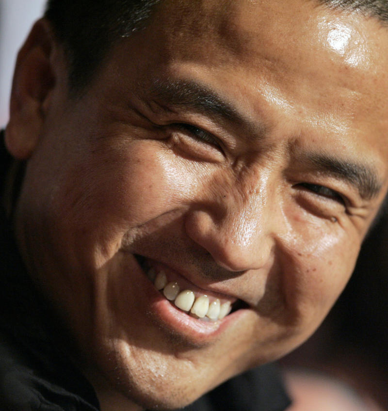 "FILE - In this May 14, 2009 file image, Chinese director Lou Ye smiles during a press conference at the 62nd International Cannes Film Festival in Cannes, southern France. Lou's new dark melodrama titled ""Mystery"" is heading the list of entries in the best film category at Taiwan's 49th Golden Horse Film festival - the Chinese-language Oscars - catapulting the mainland cinema to center stage at this Nov. 24, 2012 event. (AP Photo/Lionel Cironneau, File)"