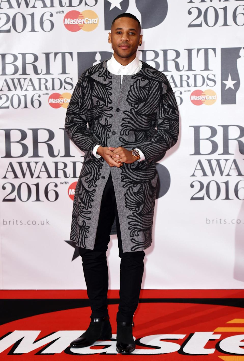 <p>Reggie donned a statement jacket, which we have to admit we love. <i>[Photo; Rex]</i></p>