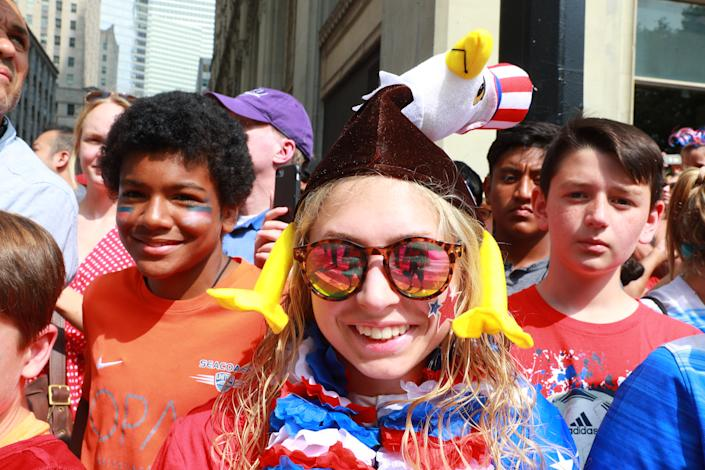 Fans dressed in patriotic clothing watch the U.S. Women's National Soccer Team Victory Parade on July 10, 2019, in New York. (Photo: Gordon Donovan/Yahoo News)