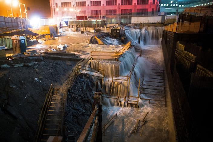 Seawater floods the Ground Zero construction site during Superstorm Sandy in New York on Oct. 29, 2012. (Photo: John Minchillo/AP)