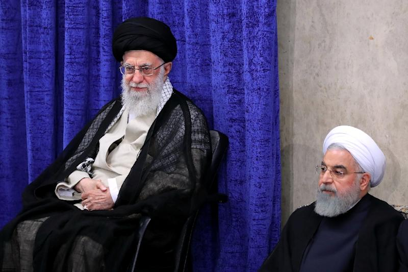 Iran's supreme leader Ayatollah Ali Khamenei and President Hassan Rouhani at a government meeting