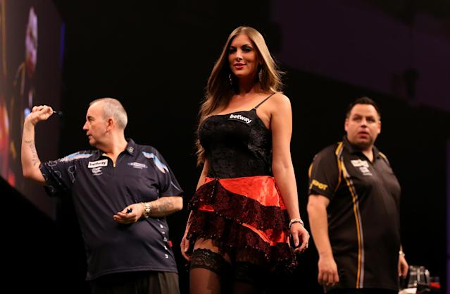 Double top: Phil Taylor, Adrian Lewis and an un-named walk-on girl, at the Motorpoint Arena in Cardiff